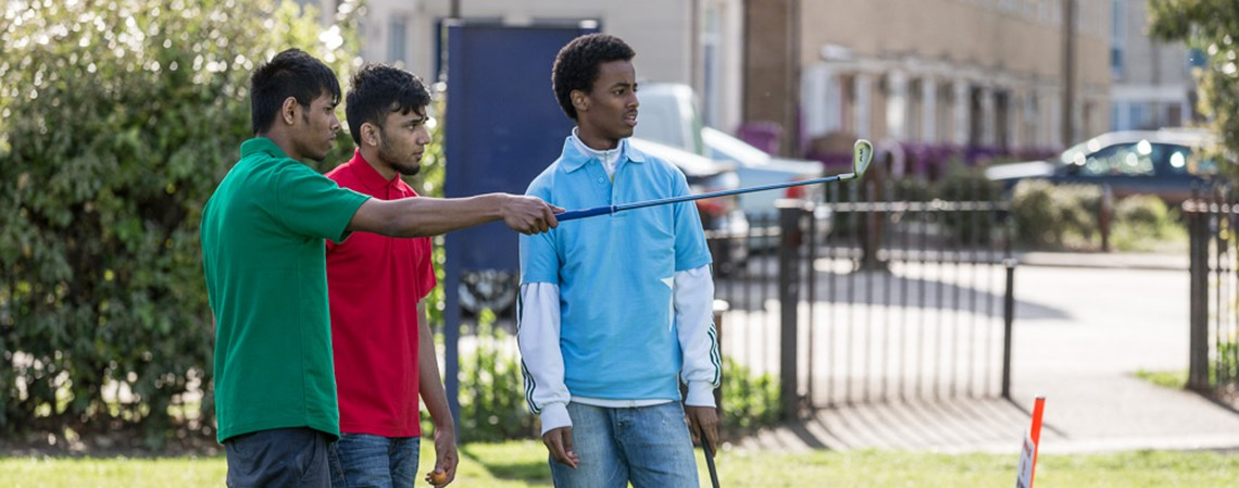 Boys playing StreetGolf in Tower Hamlets