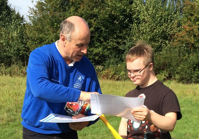 Disabled boy receives certification at Henley Hall GC
