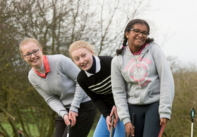 Girls laughing at Girls Golf Rocks session in Nottinghamshire