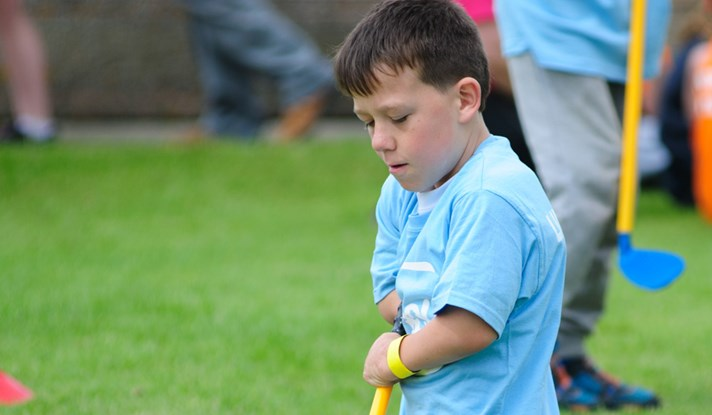 Disabled boy playing Tri-Golf at Lincolnshire school games (close up)