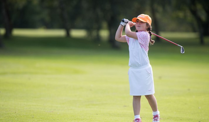 Girl holding club at Howley Hall GC event
