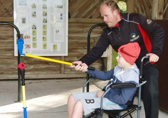 Bris & Clif GC coaching child with cerebal palsy cropped.jpg
