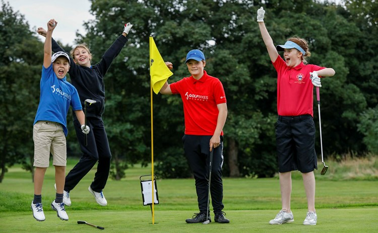 Samara from Bedlingtonshire (second  from right) gets amazing hole in one.jpg