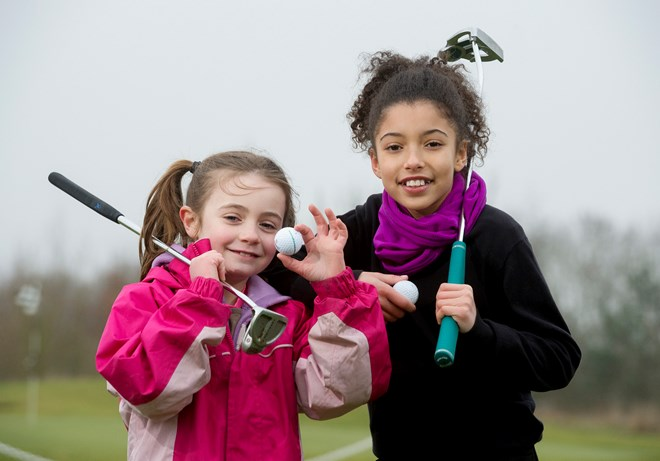 LB_GGR_Beds 2 girls holding golf ball.jpg