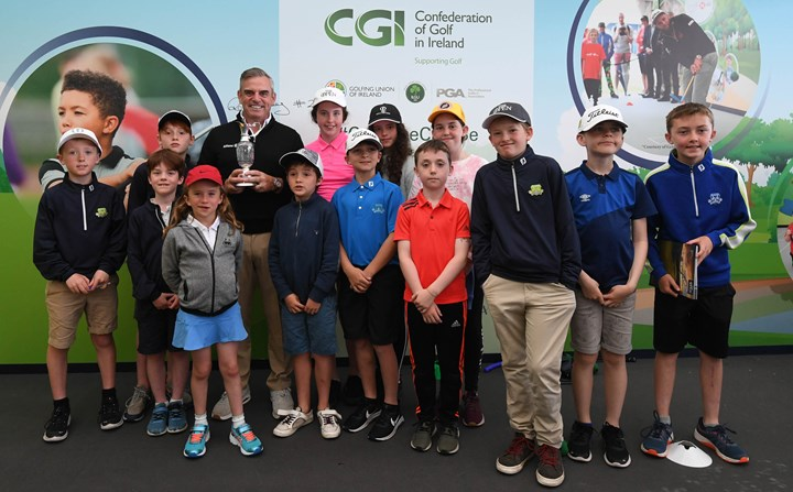 Paul McGinley with juniors cropped.jpg