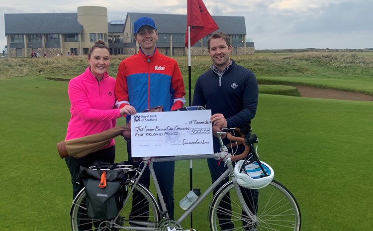 Luke presented with cheque from Dep CEO Adair Simpson, right, and Rebecca Tulley left.jpeg