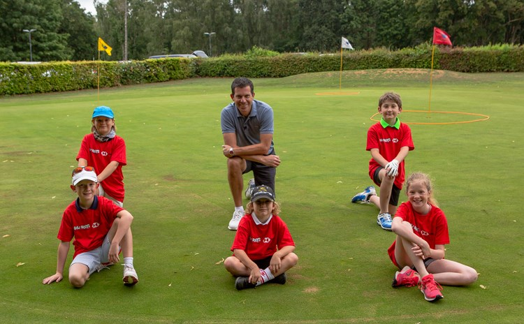 Tim Henman and junior golfers at Frilford Heath